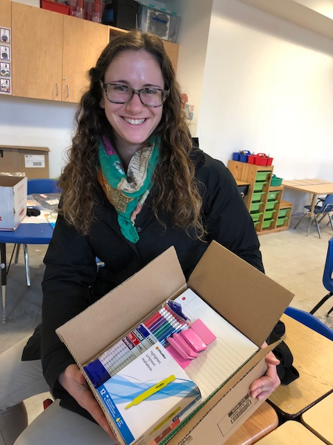 The Intergenerational School Teacher with box of supplies